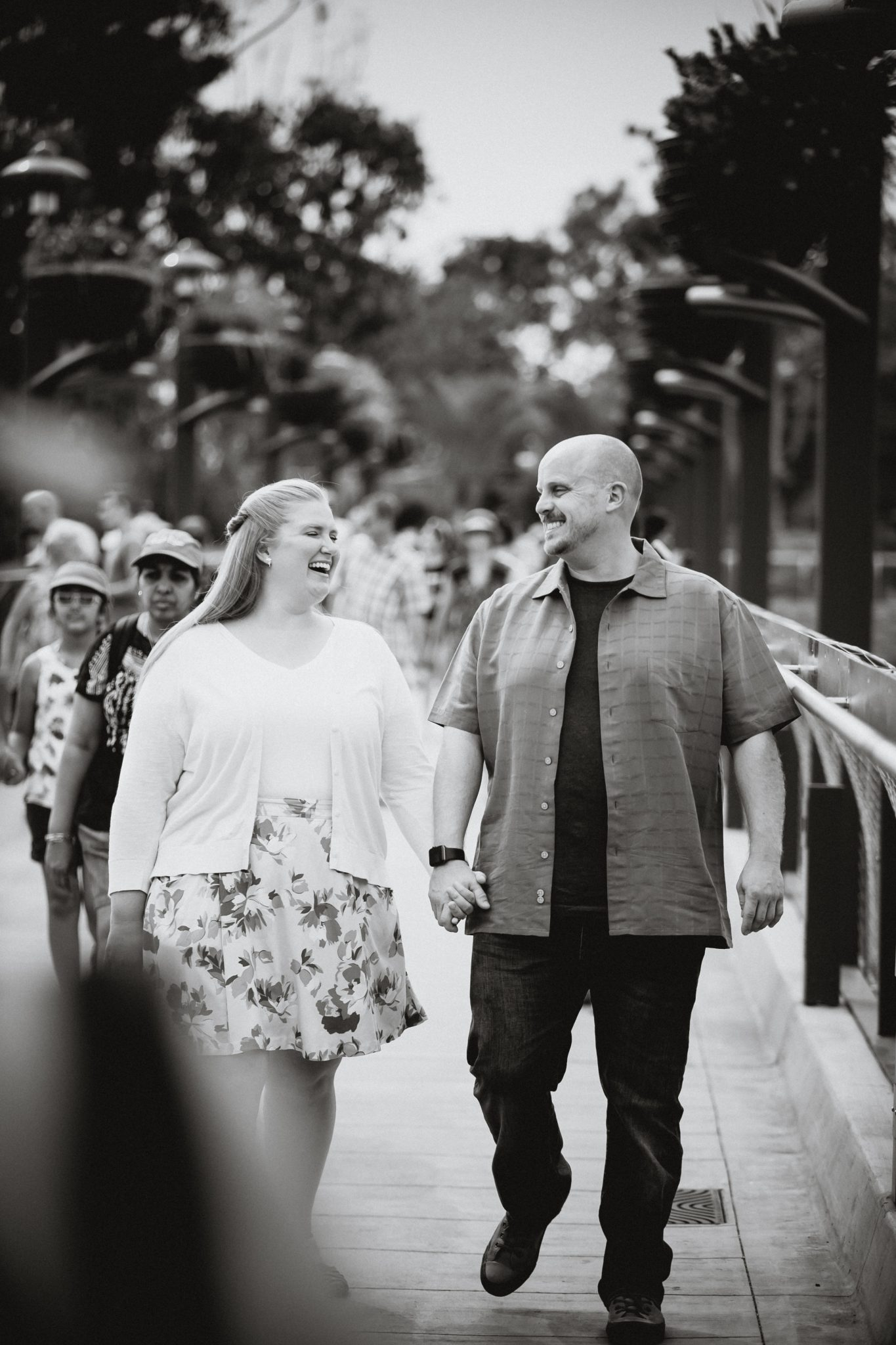 Couple walking and laughing during their portrait shoot