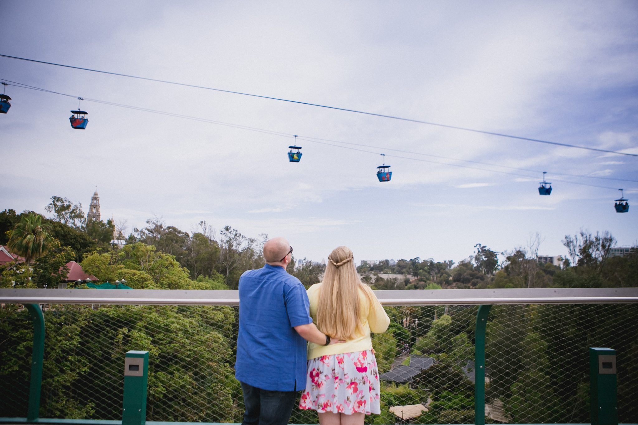 Couple on a bridge looking at the Skyfari Aerial Tram