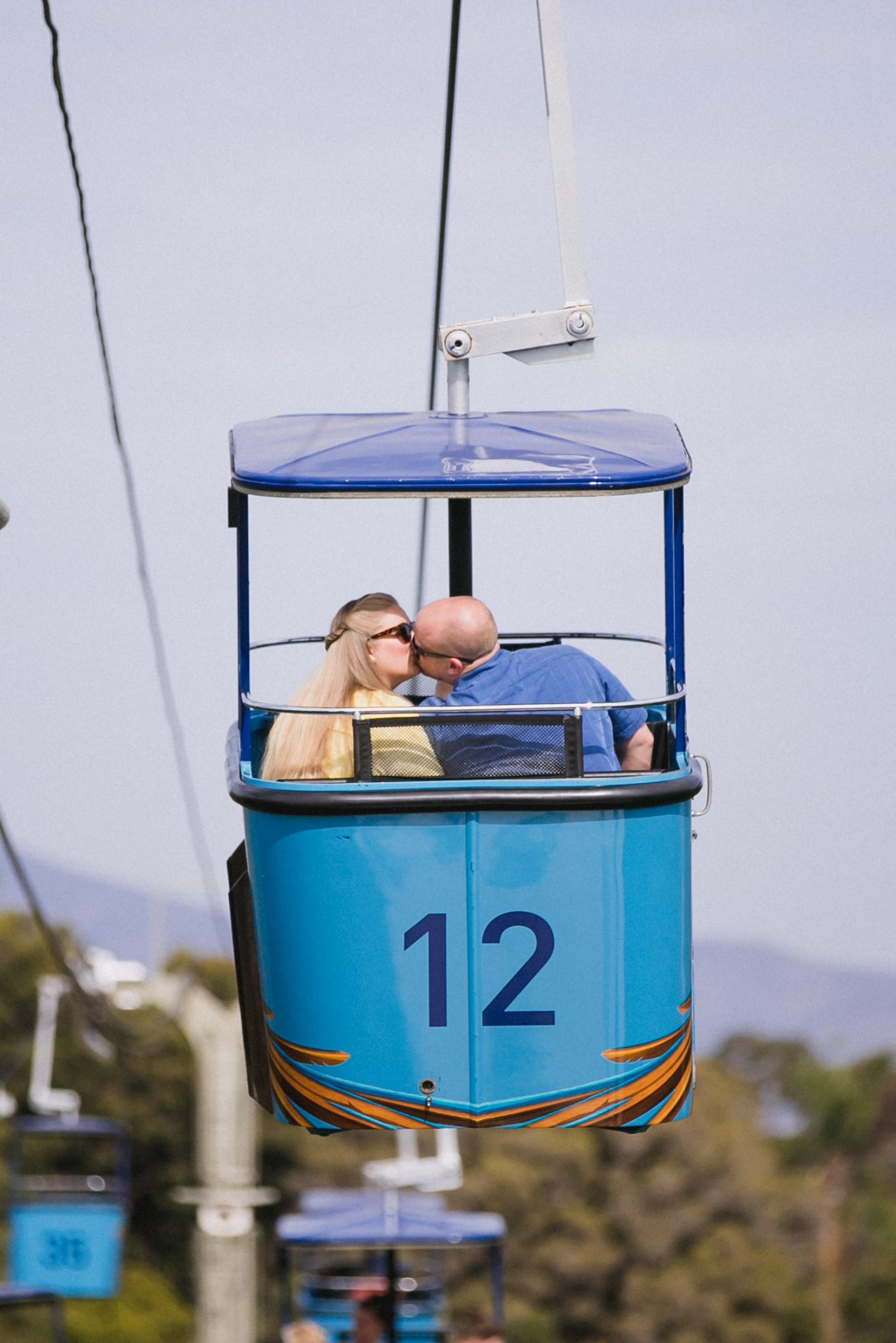 Man and woman kissing in gondola ride at the zoo