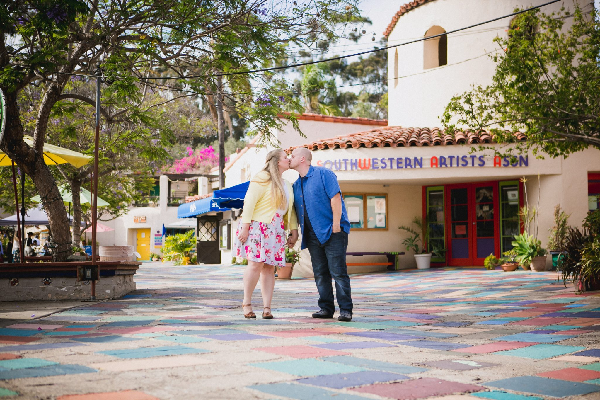 Kissing in a colorful location in San Diego, CA