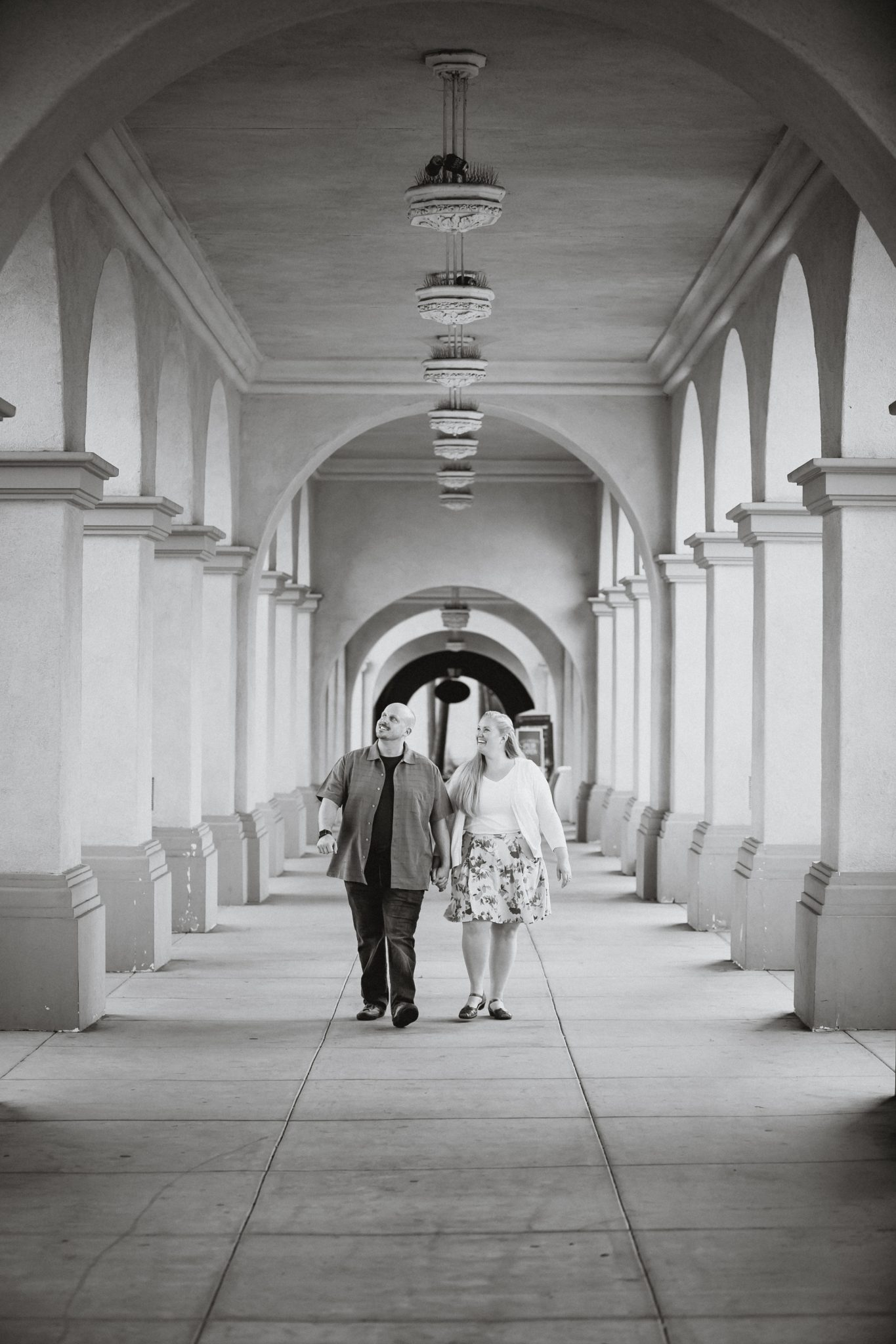 Guy and girl walking between columns