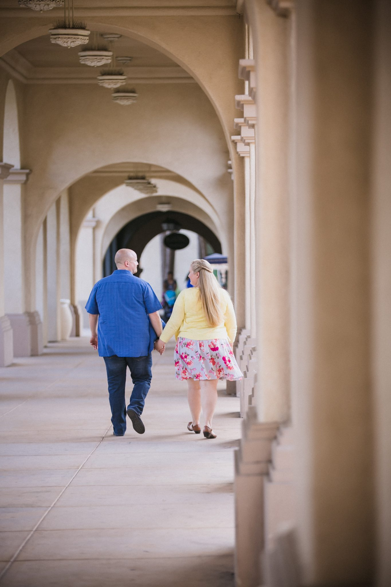 Couple walking and holding hands at Balboa Park