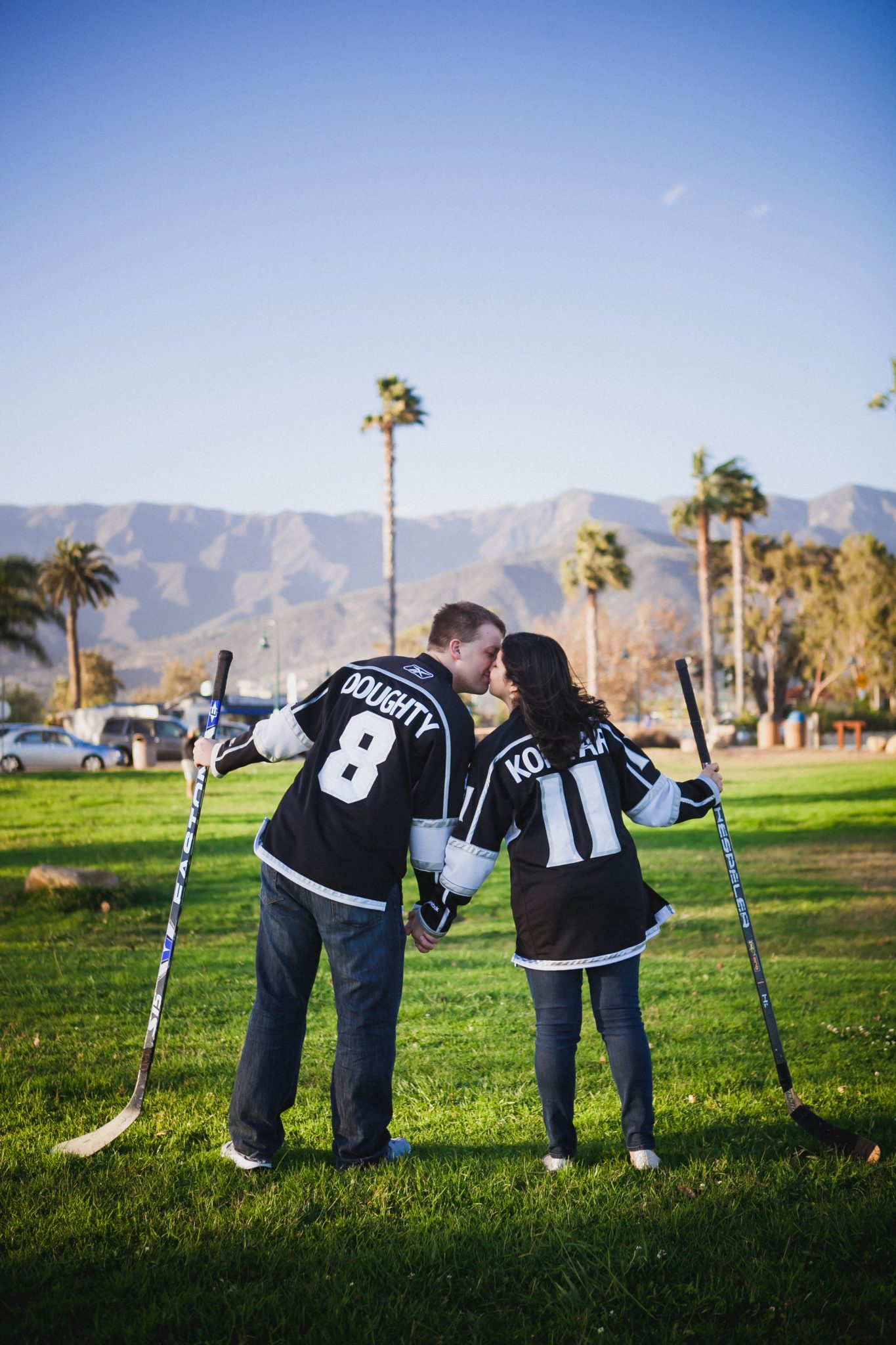 Couple wearing Kings hockey jerseys during a photo shoot