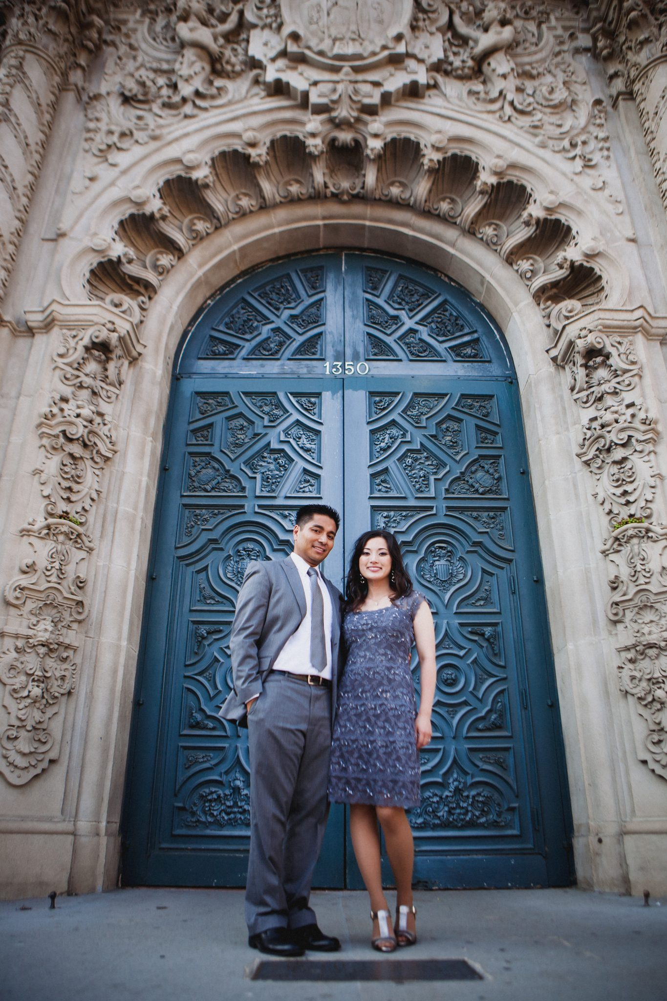 Couple dressed in formal clothing for their engagement pictures