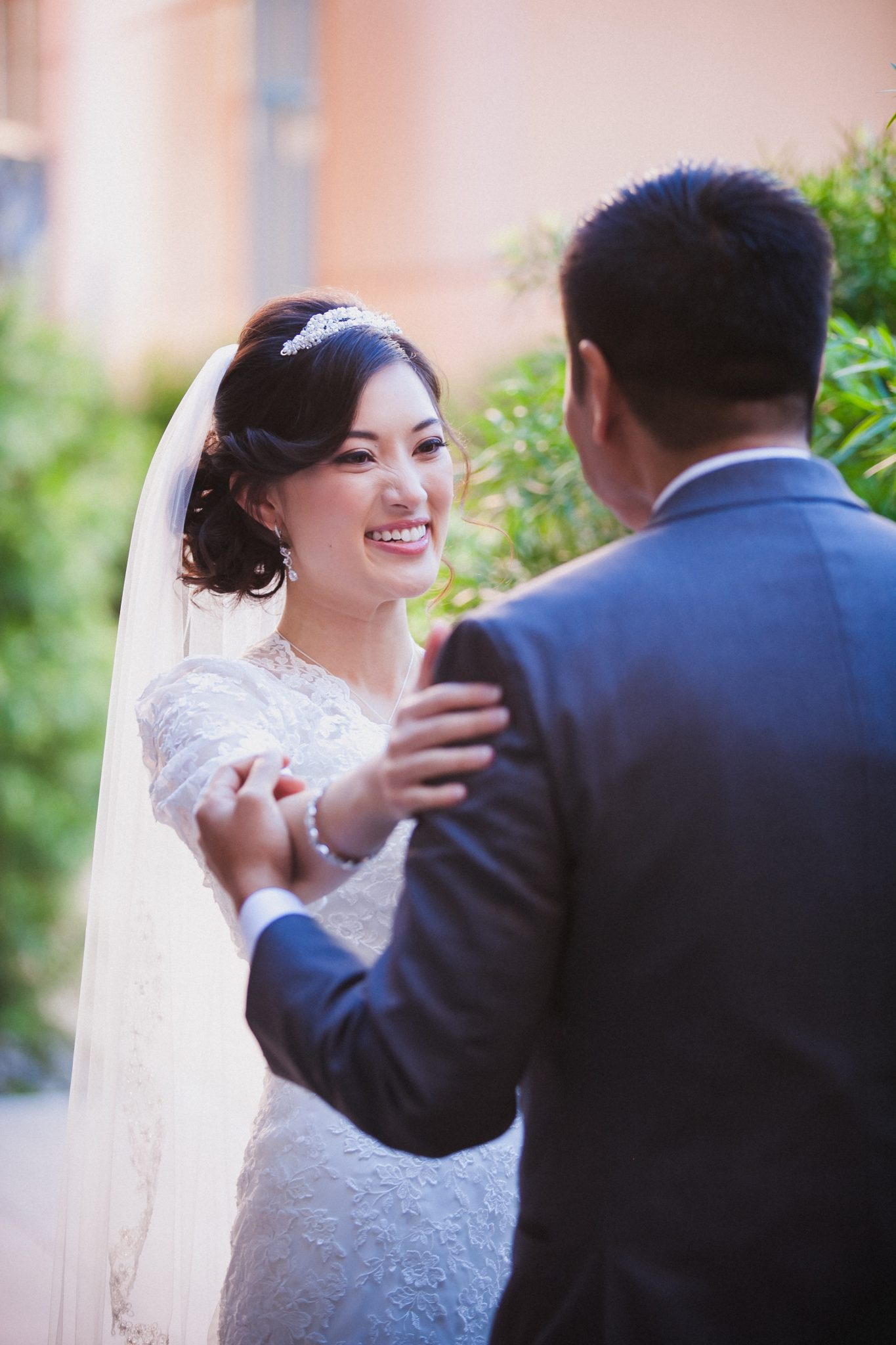 Bride smiles as she sees the groom during the first look