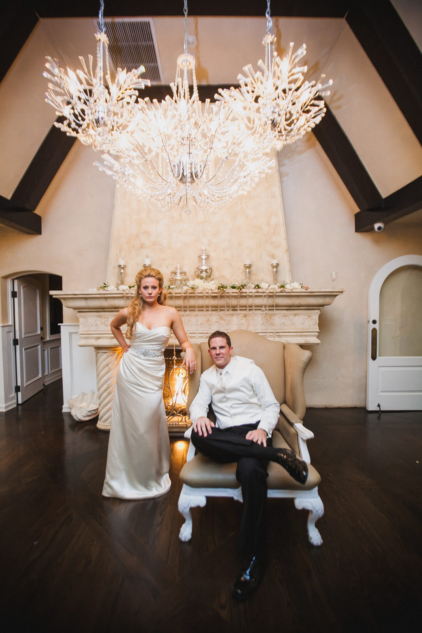 Indoor portrait of a couple under a chandelier