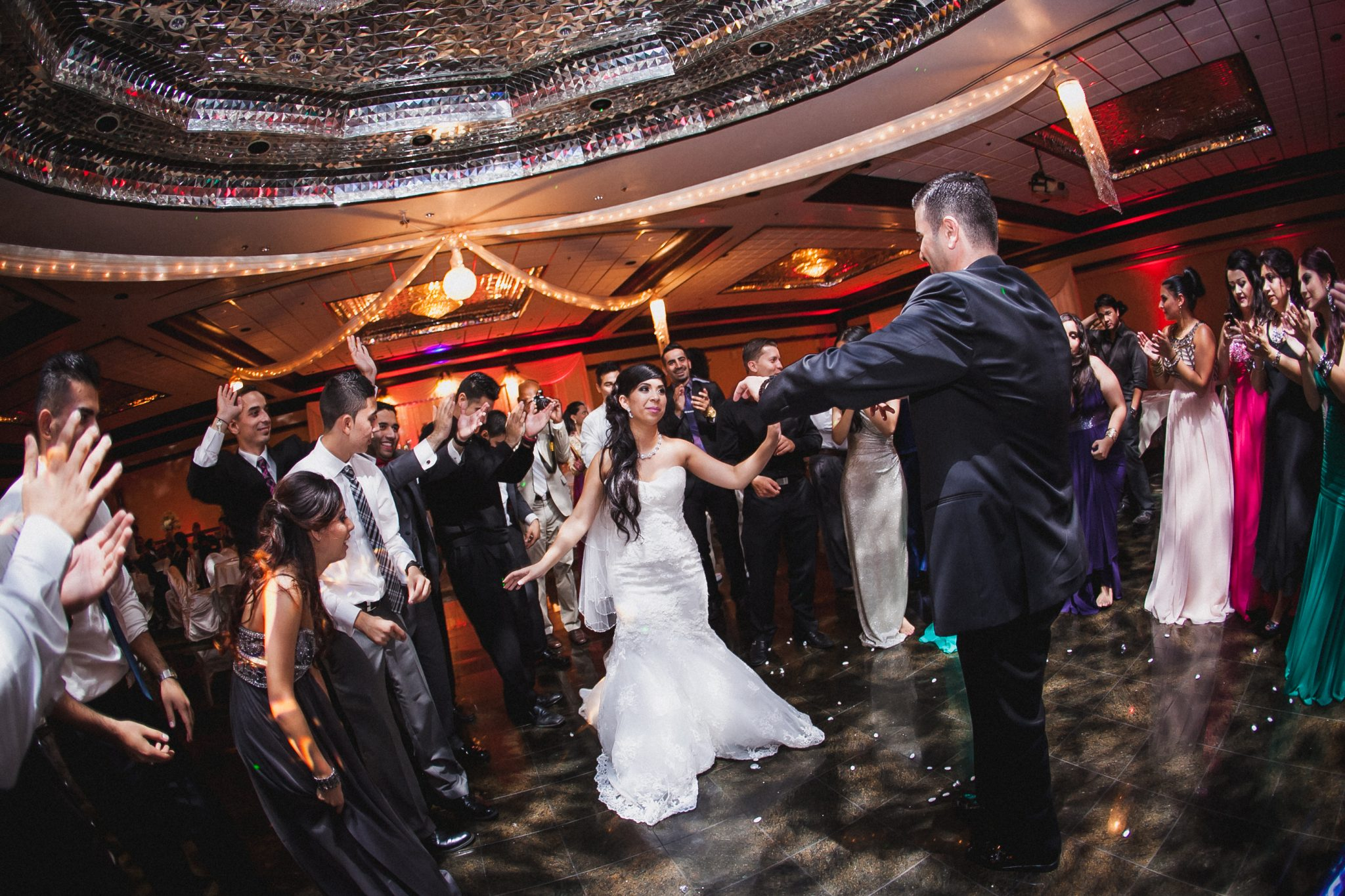 Bride and groom dancing in the middle of a circle at the reception
