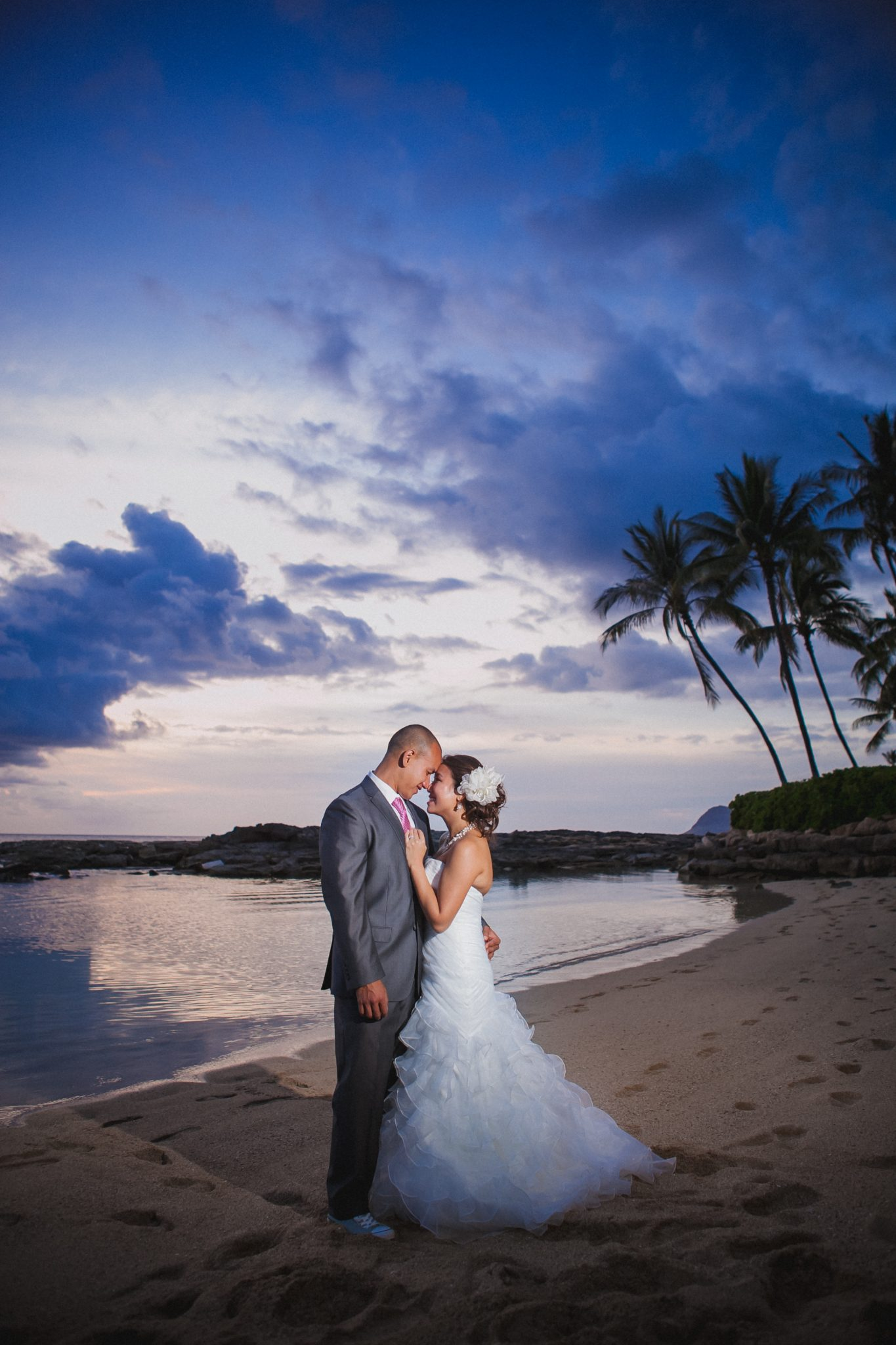Hawaiian sunset in the background of a couple portrait