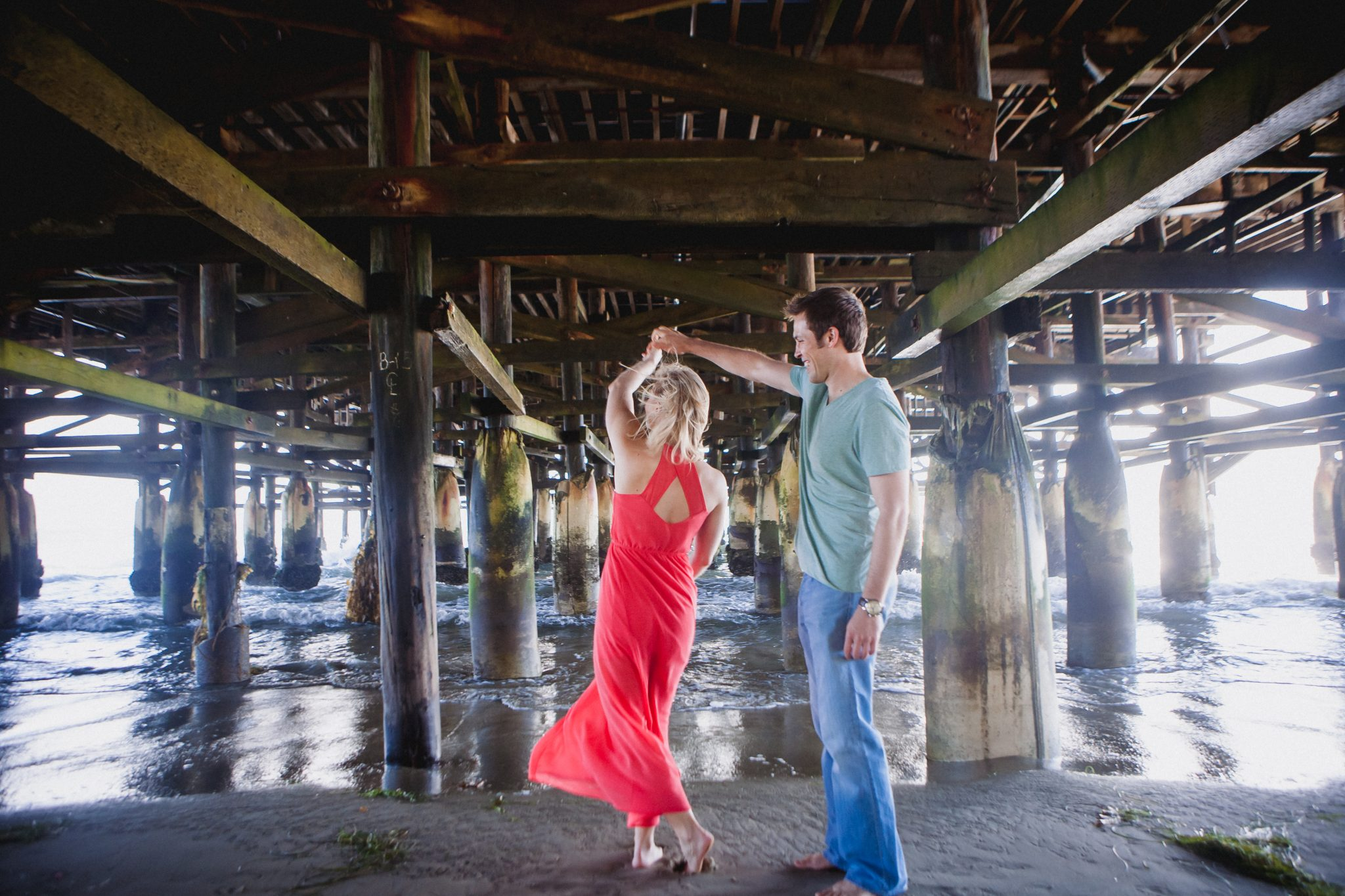 Long dress for photo session under the pier in San Diego
