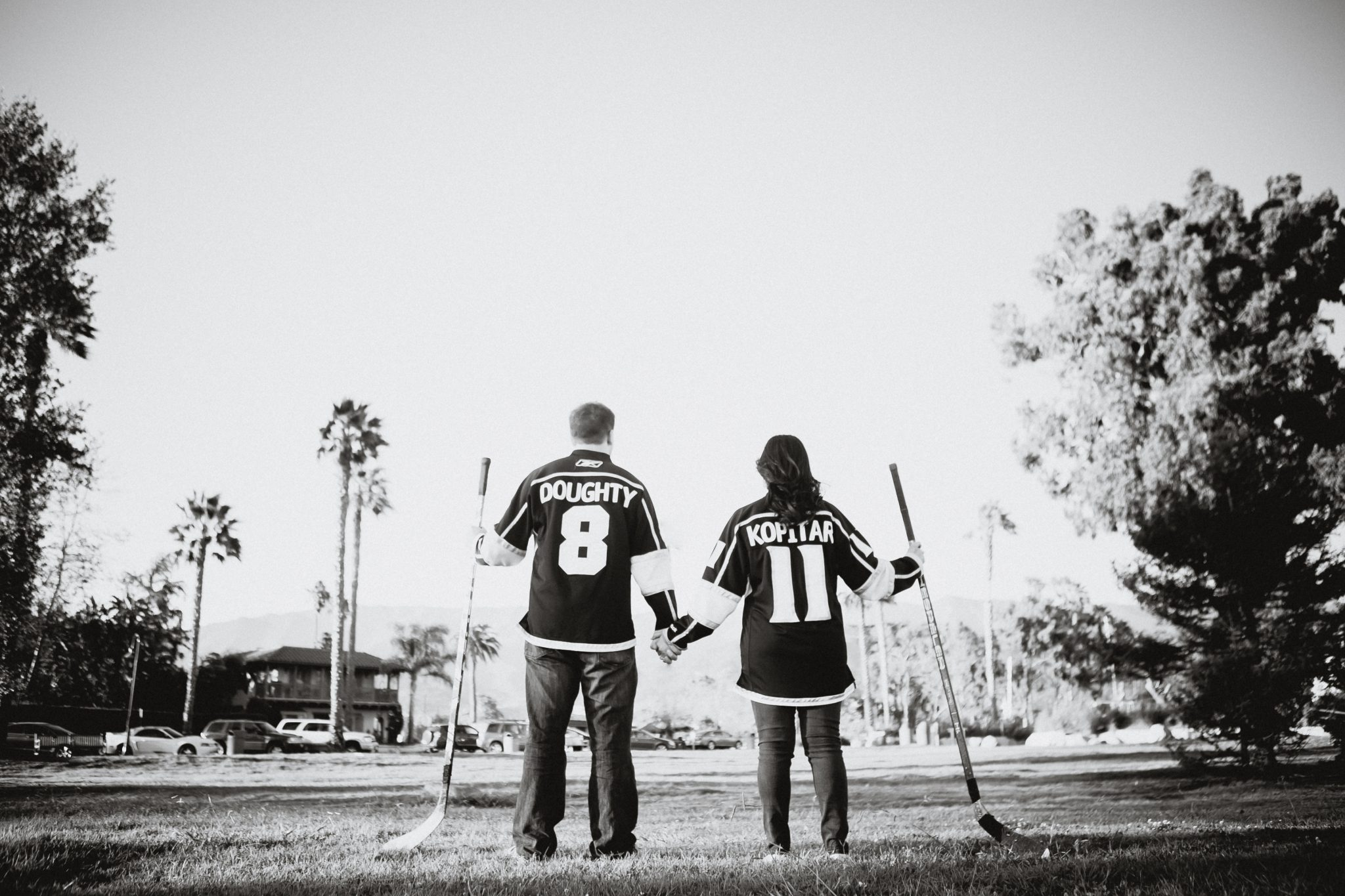 Couple wearing hockey jerseys during engagement pictures