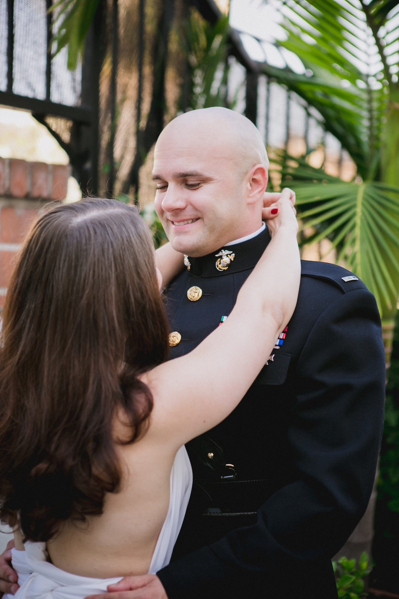 Groom smiling at his bride on wedding day