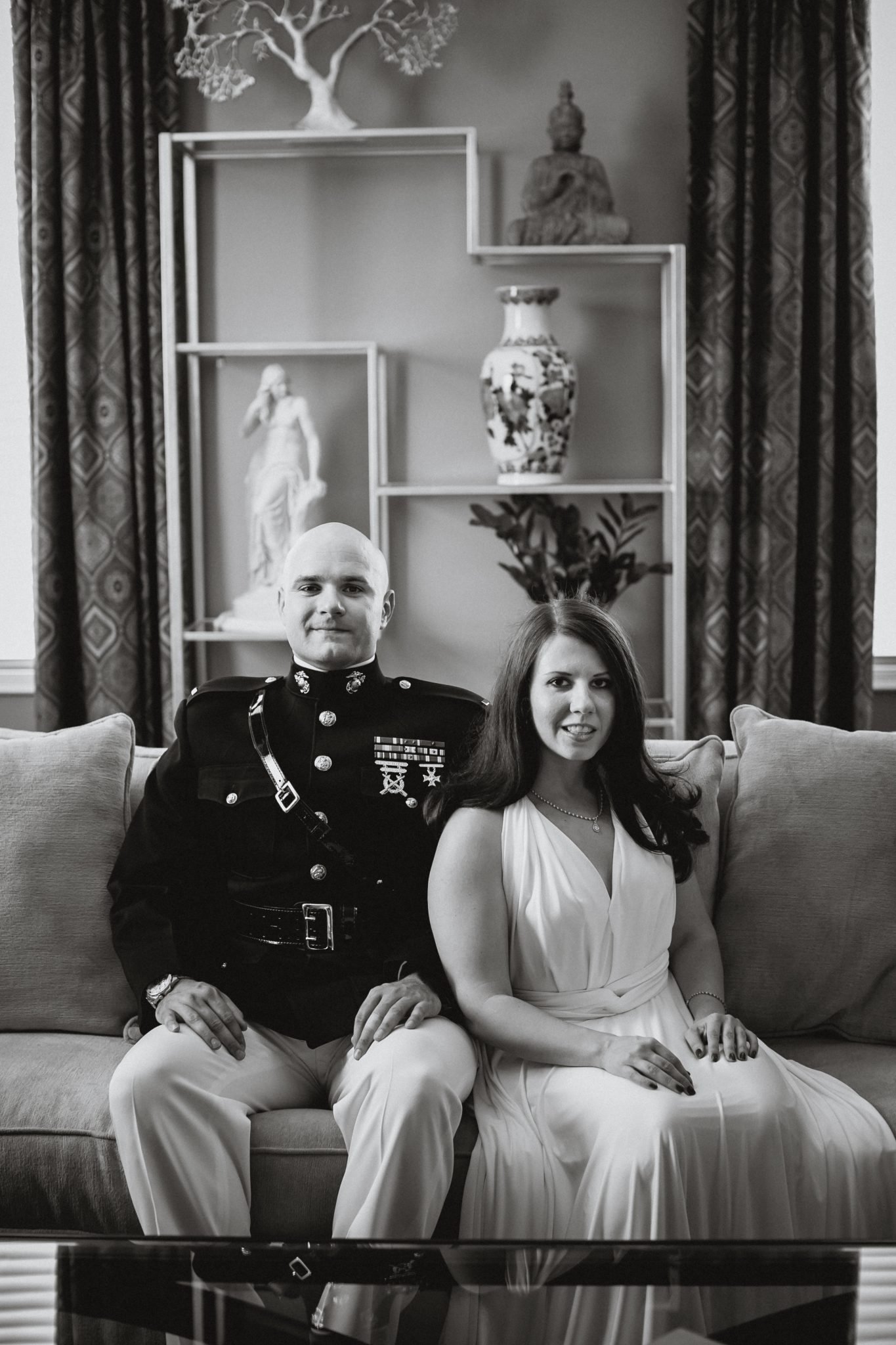 Black and white portrait of the couple sitting on a couch