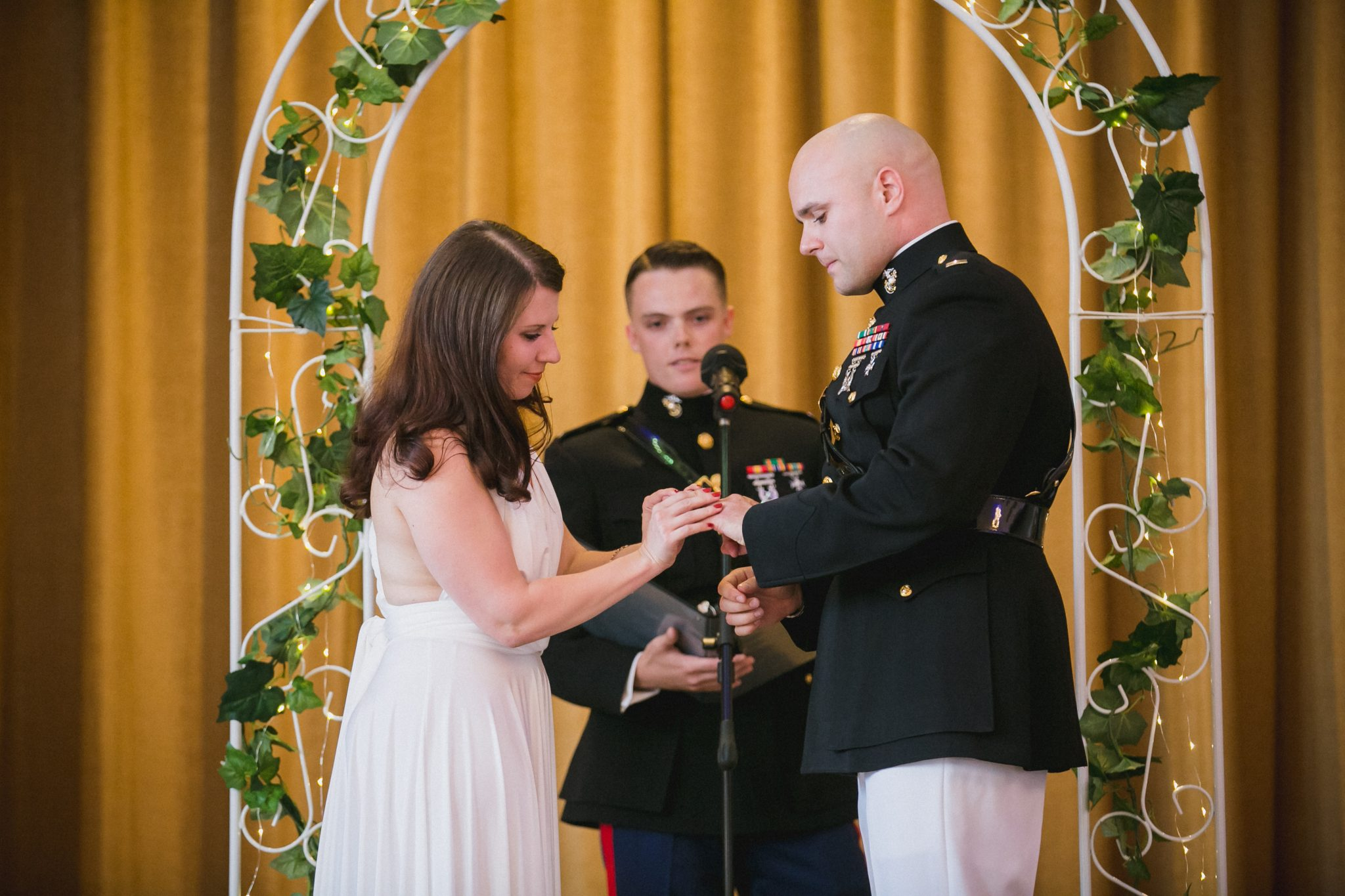 Bride placing wedding ring on the groom during the ceremony