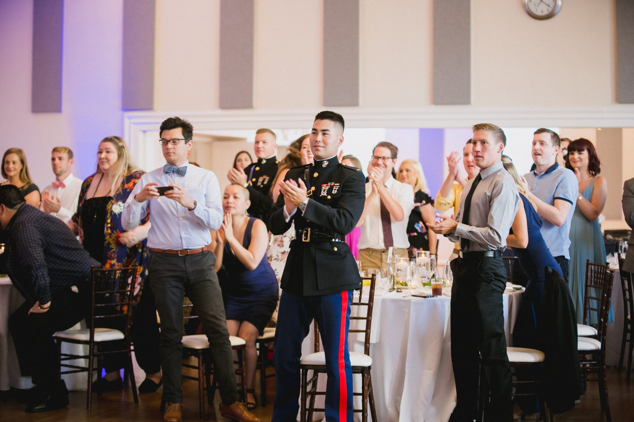 Wedding guests clapping at the end of the ceremony