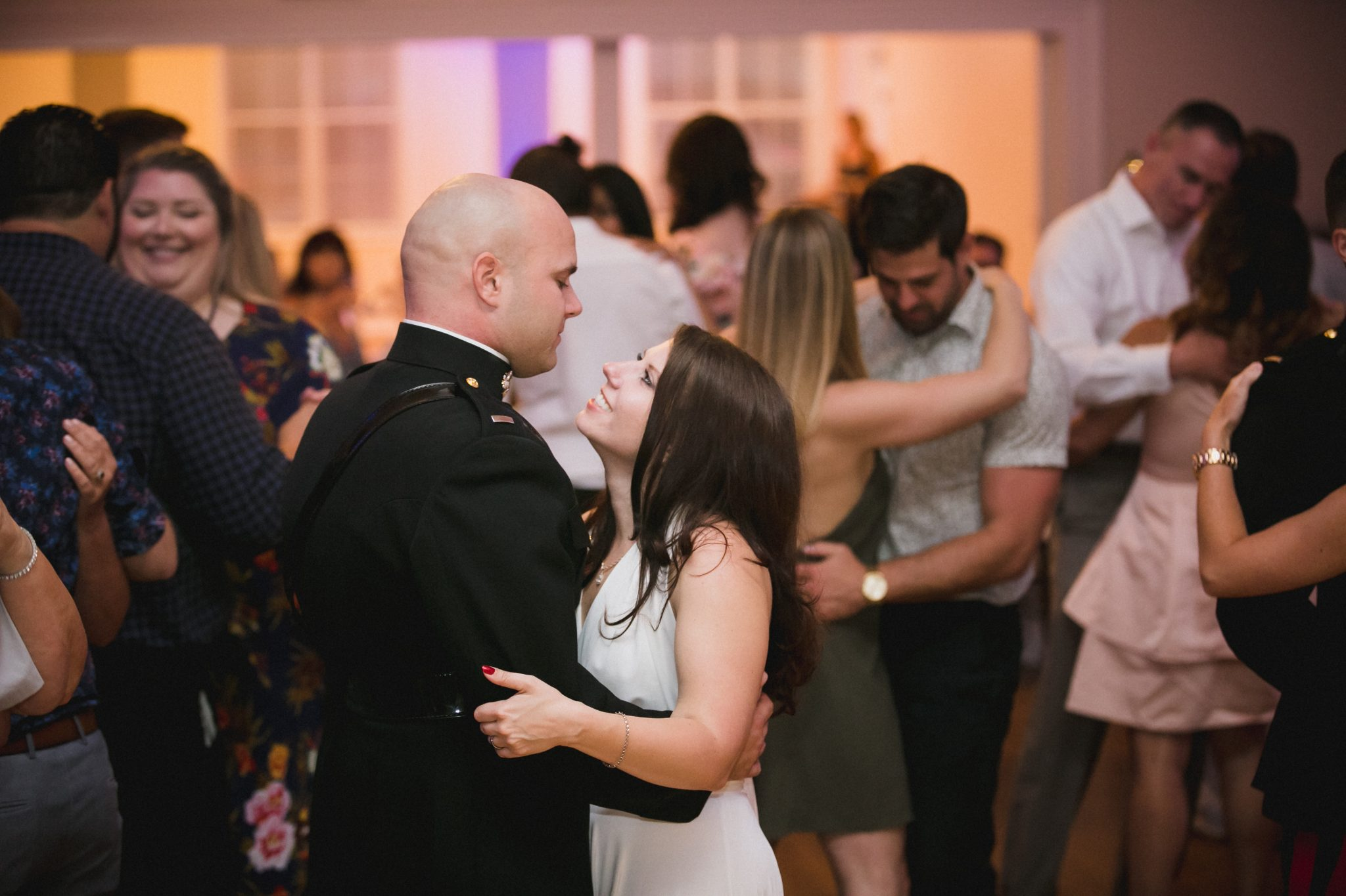 Bride smiles at the groom during their first dance