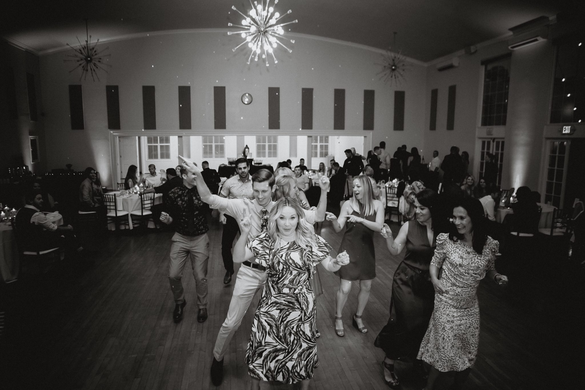 Black and white photo of open dancing at a wedding