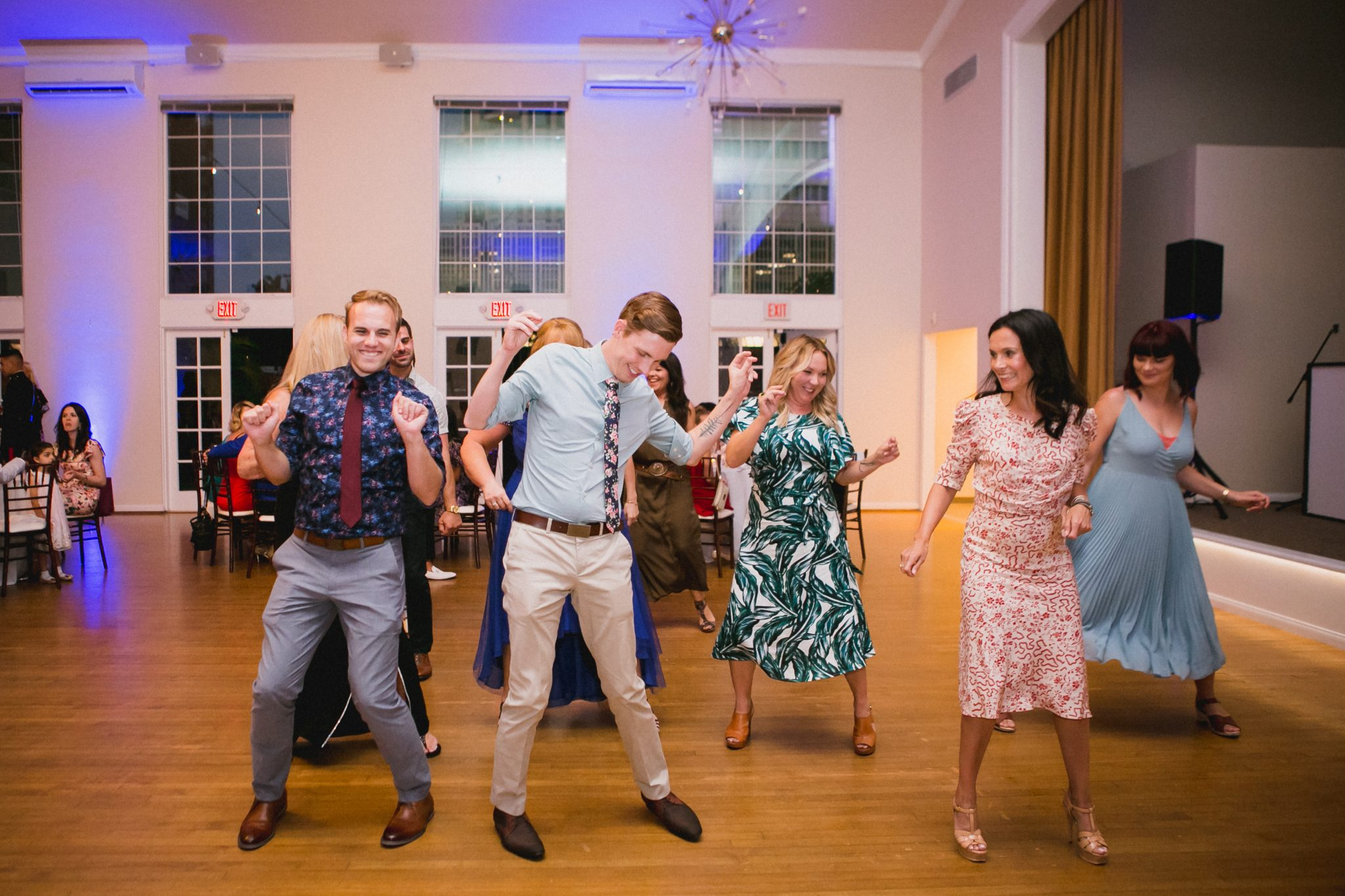 Wedding guests doing the cha cha slide at a reception