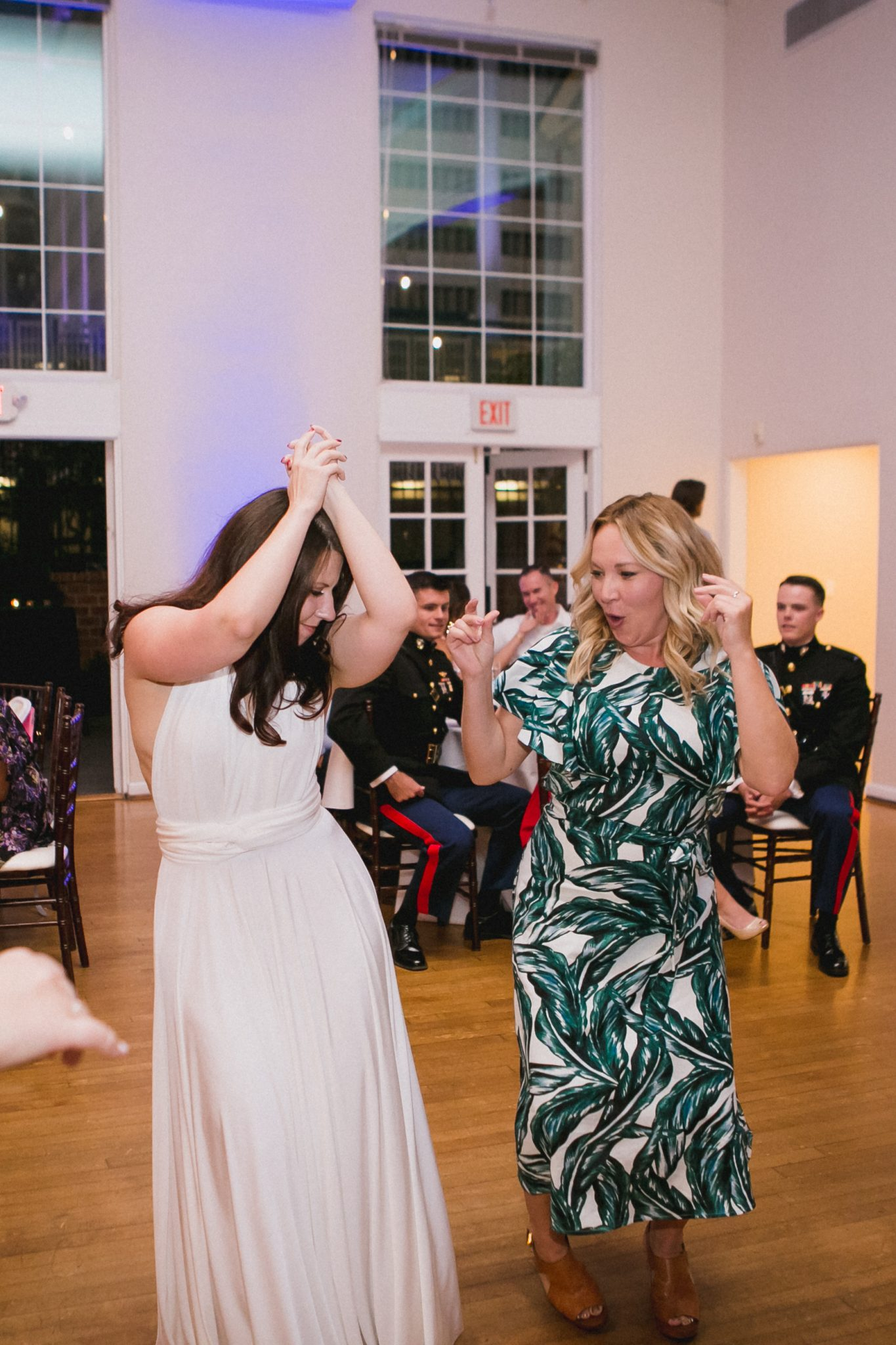 Bride dancing with her arms in the air