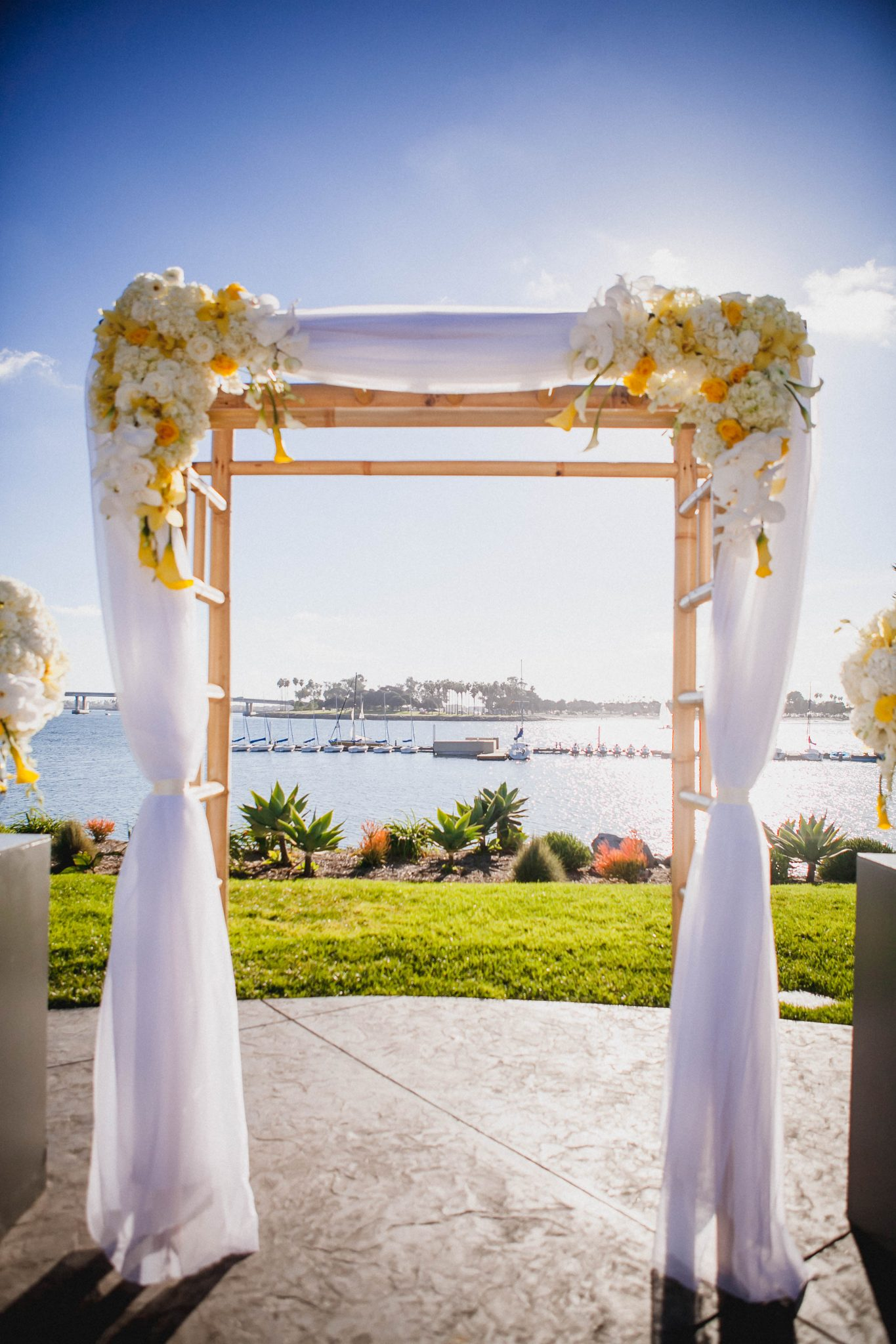 Wooden arbor for wedding ceremony overlooking the bay in San Diego