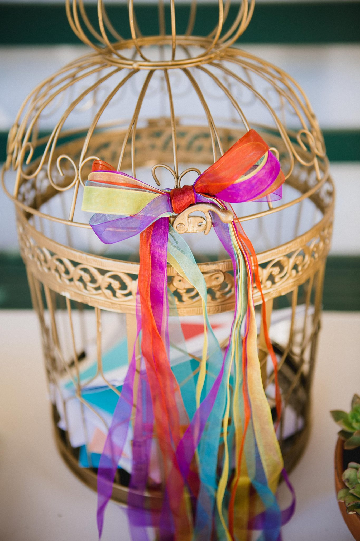 Gold bird cage decoration for guests to place wedding cards in