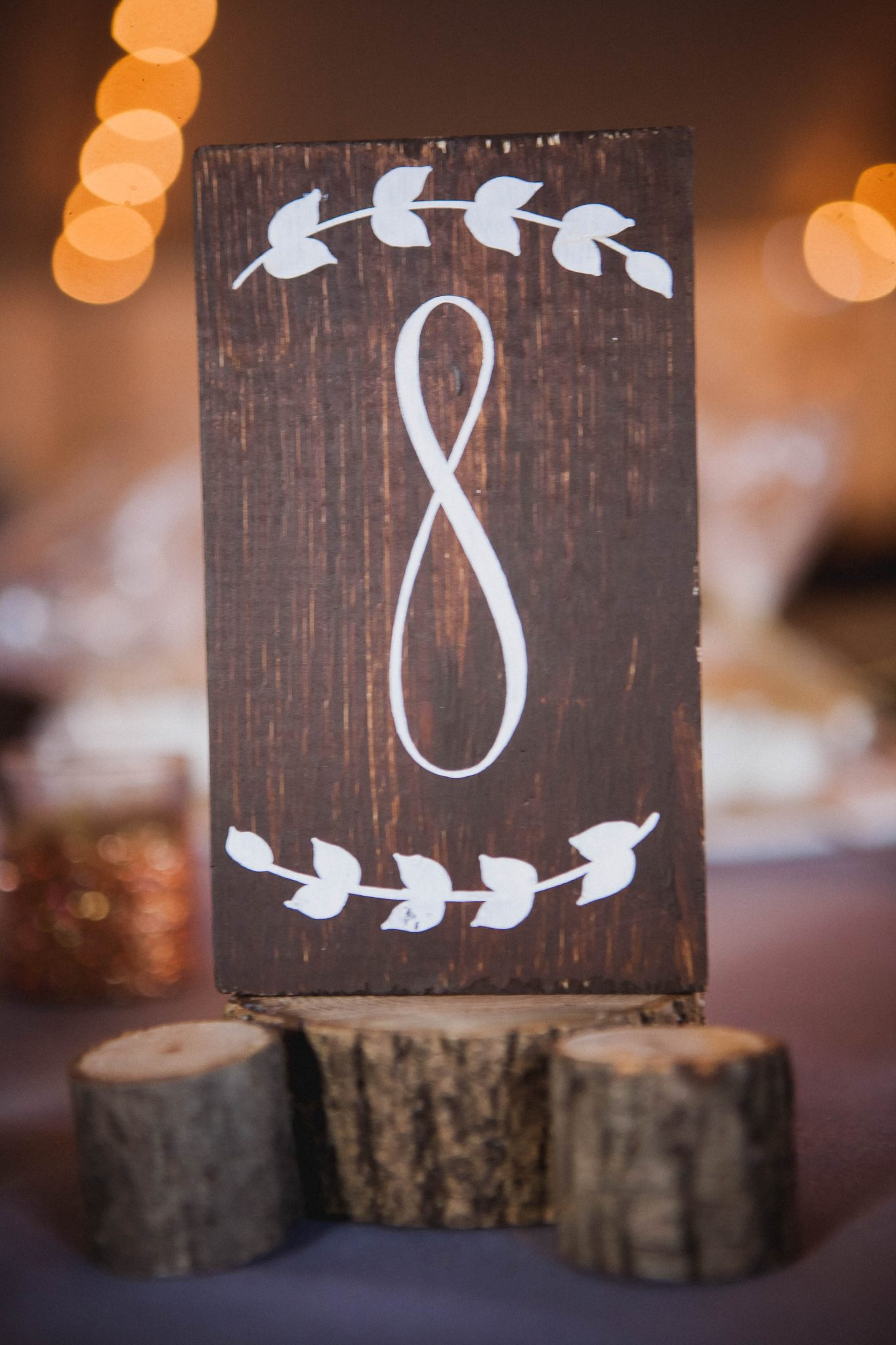 Wooden sign with painted numbers for the wedding reception table numbers