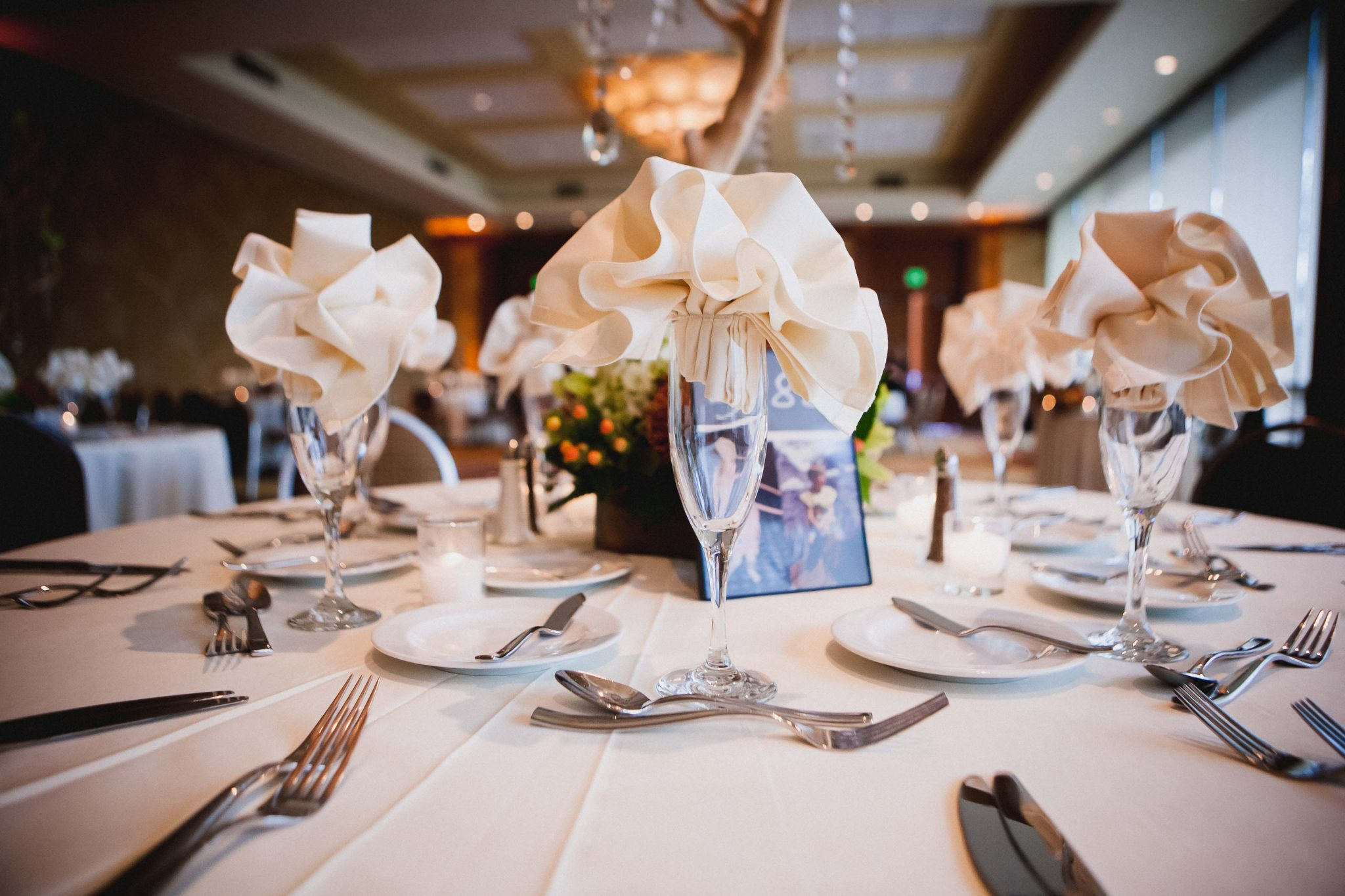 Wedding champagne glasses with cloth napkins folded inside them at a wedding reception