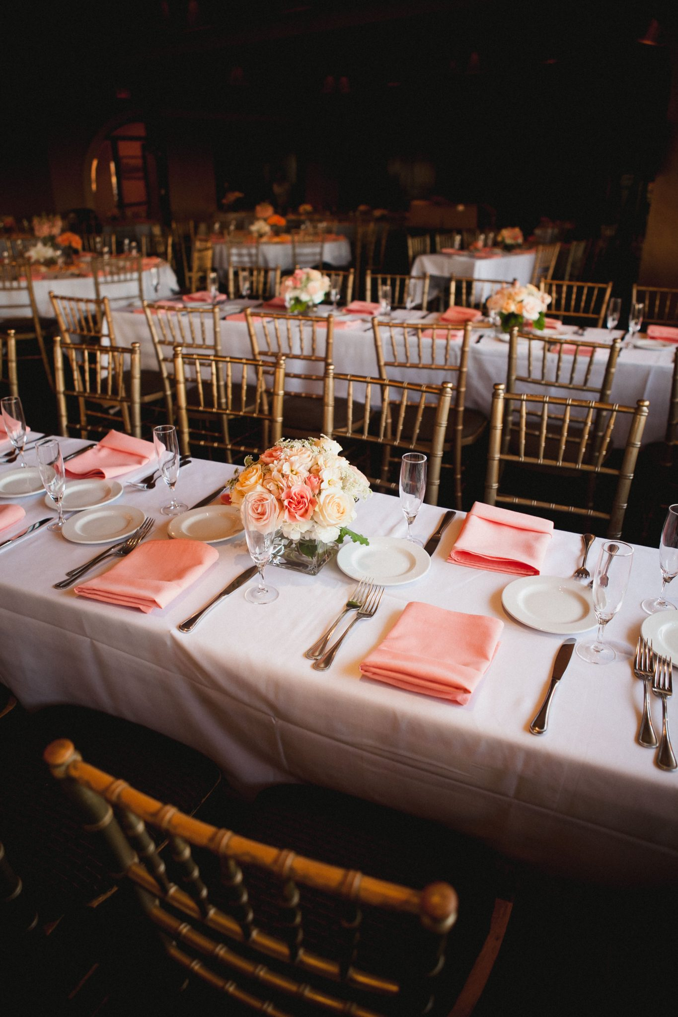 Pink cloth napkins as part of the wedding reception decorations