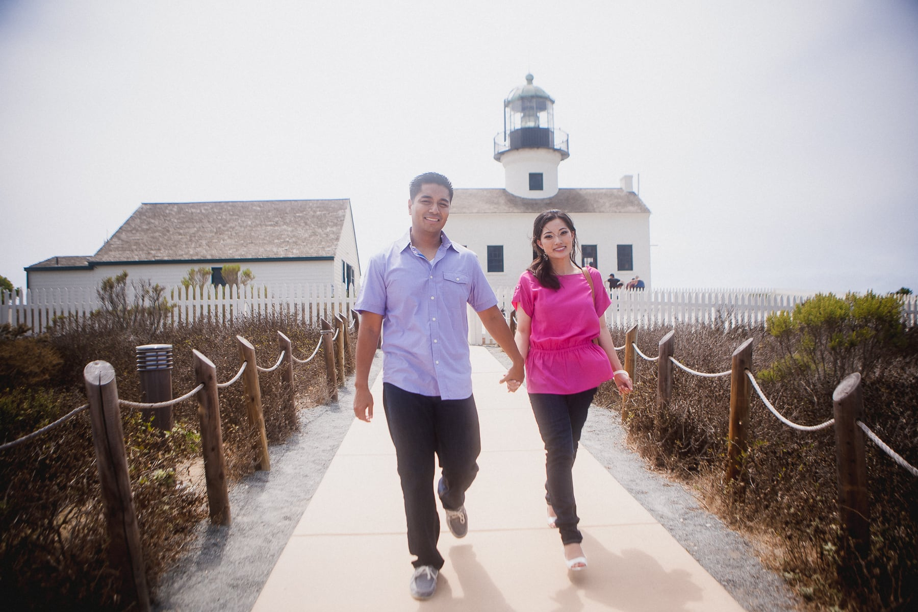 Cabrillo National Monument engagement session with the lighthouse in the background