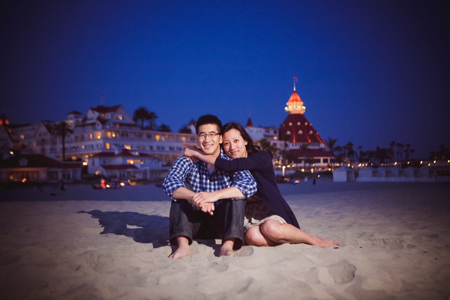 Engagement pictures at night on Coronado with the Hotel Del