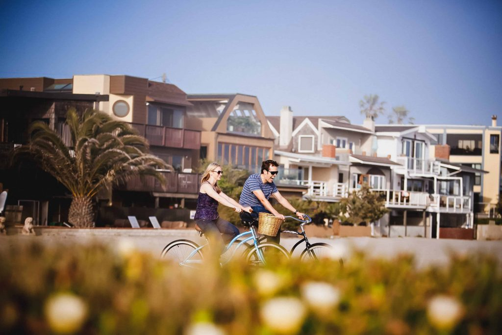 Bike riding in Mission Beach during their engagement shoot