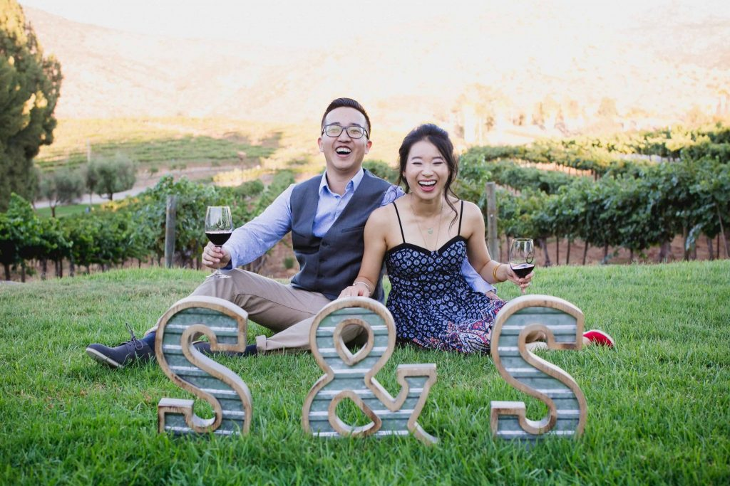 Engagement photos with metal letter props