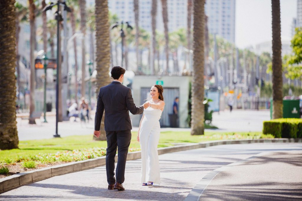 Wedding couple dancing in the street in San Diego