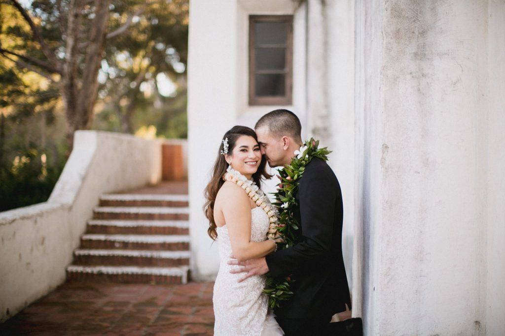 Bride and groom couple portrait with Hawaiian leis