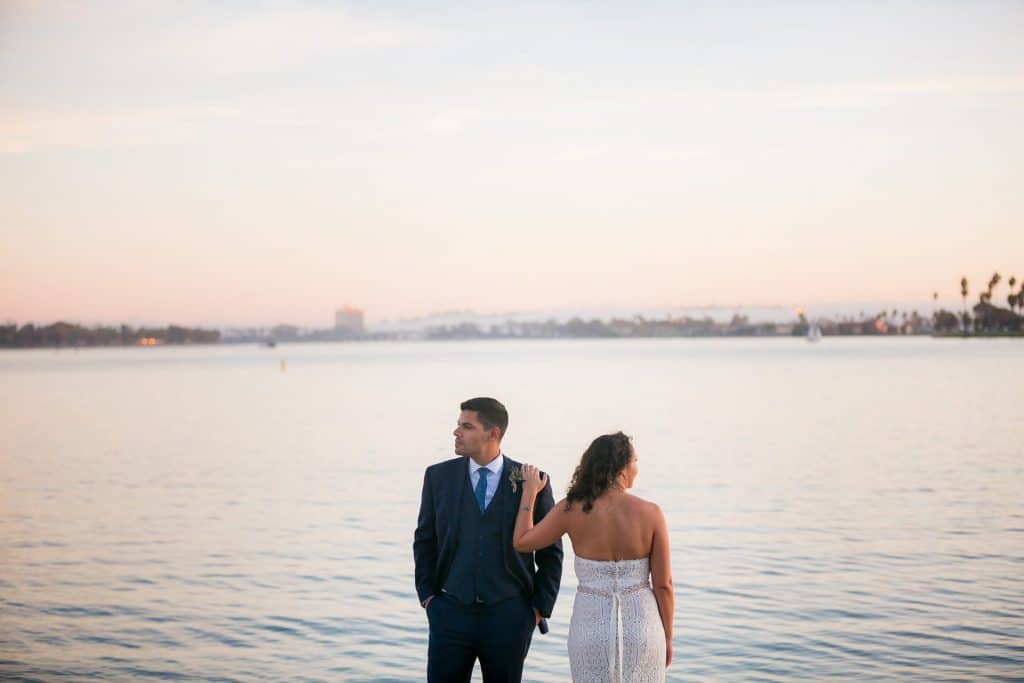 Couple standing in front of the water at Mission Bay on their wedding day