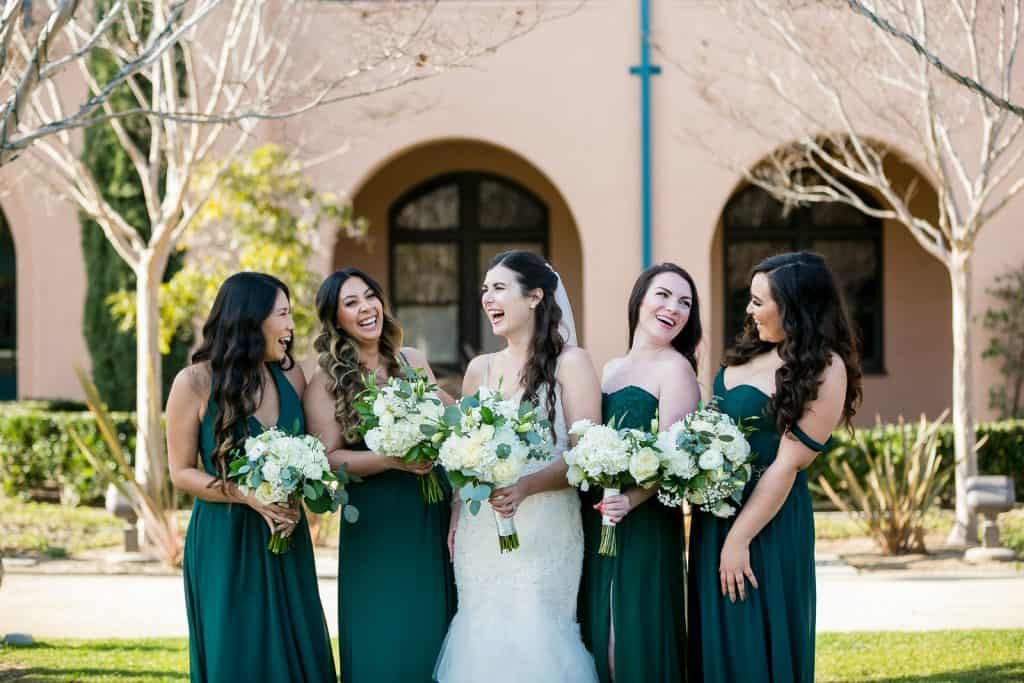 San Diego wedding photographer taking an outdoor photo of the bride and her bridal party