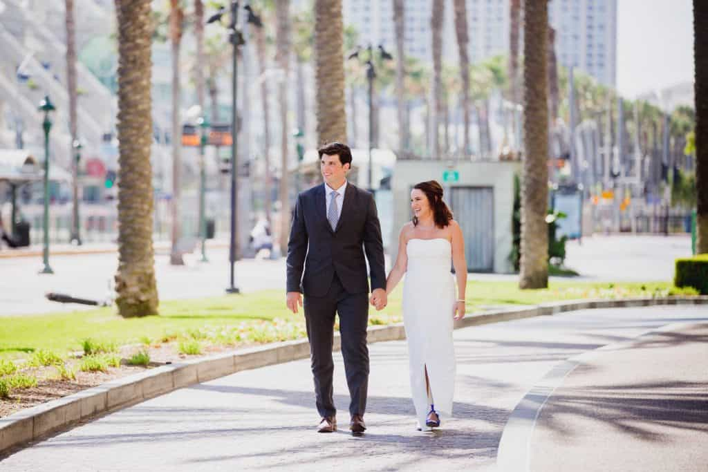 Alli and Jason being photographed in Downtown San Diego on their wedding day